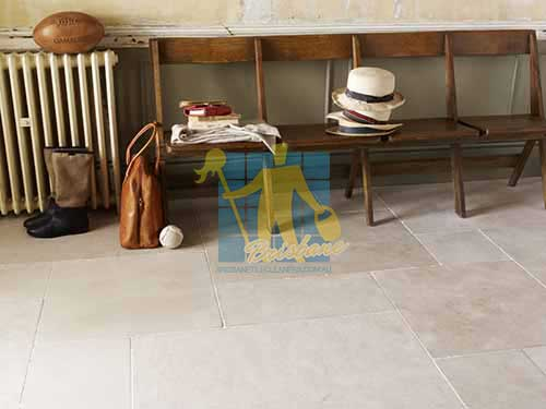 Brisbane limestone tile sample storm tumbled white grout wooden chair