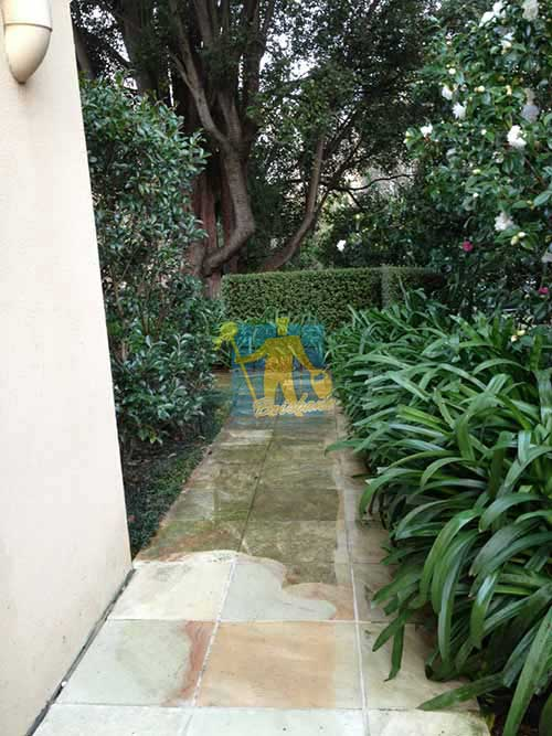 outdoor sandstone  pavers part cleaned part dirty while cleaning in garden Brisbane
